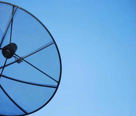 Satellite dish in blue sky Stock Photo - 14013214