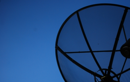 Satellite dish in blue sky  Stock Photo - 14013216