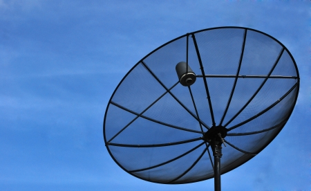 Satellite dish in blue sky  Stock Photo - 14161745