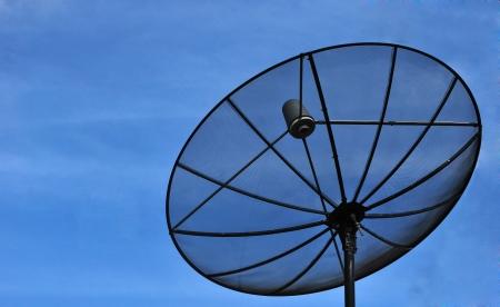 Satellite dish in blue sky Stock Photo - 14161745