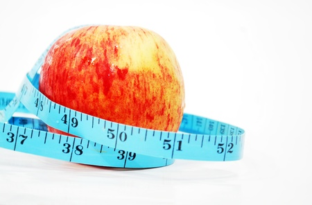 red apple with measure tape  photo