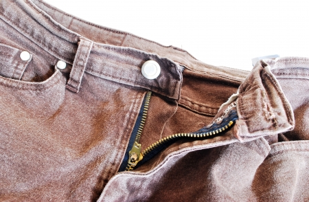 torn old brown jeans background,dirty pants  Stock Photo