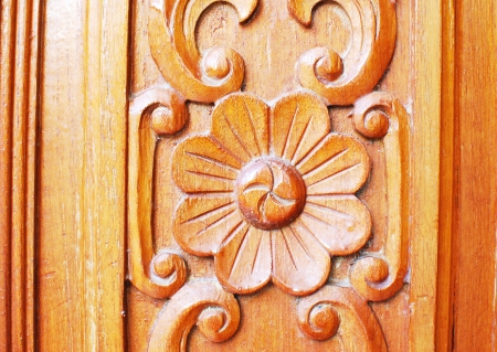 Thai emboss on wood door photo
