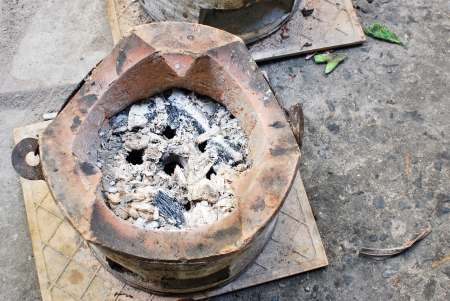 stoking: Old stove after cooking
