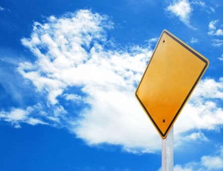 Yellow traffic sign on blue sky background