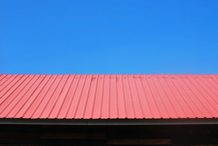 Red roof background in blue sky  Stock Photo