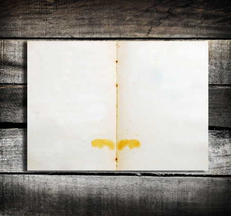 Empty note page on wood background