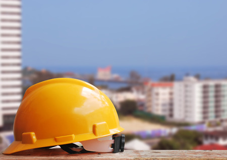 Safety helmet with construction site background