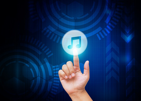 single songs: Hand pressing music button on technology background Stock Photo