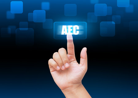aec: Hand pressing AEC buttons with technology background
