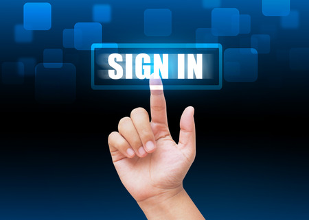 sign in: Hand pressing SIGN IN button with technology background Stock Photo