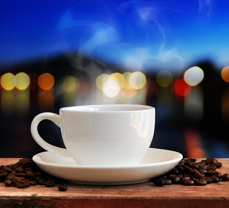 Coffee cup with twilight background Stock Photo