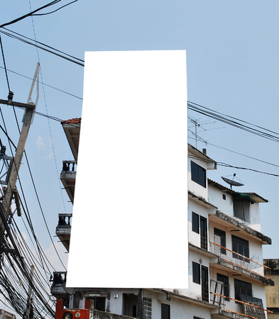 Blank billboard on the building. Stock Photo