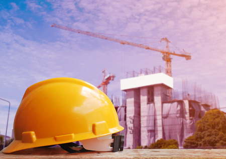 site construction: Safety helmet with railway construction background Stock Photo