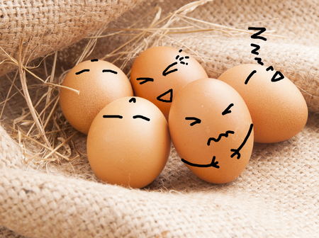 the suffering: Egg is suffering when his friends are relax. Stock Photo