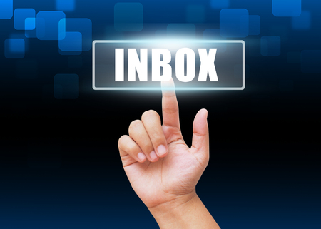 inbox: Hand pressing Inbox button with technology background Stock Photo