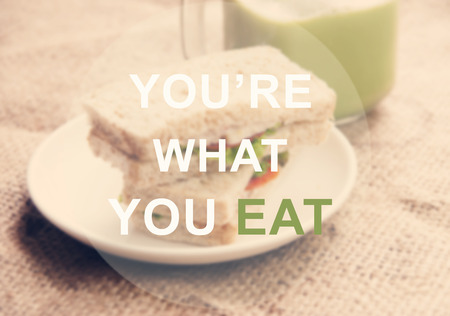 what to eat: Youre what you eat, text on breakfast background Stock Photo