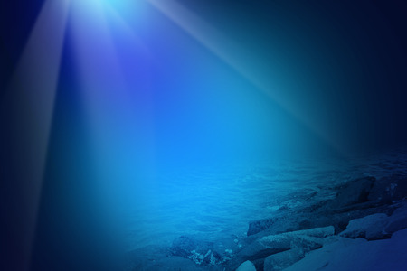 beneath the surface: Deep blue sea background with sunlight shining