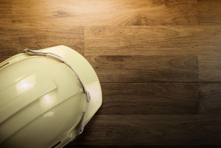 Safety helmet on work table background