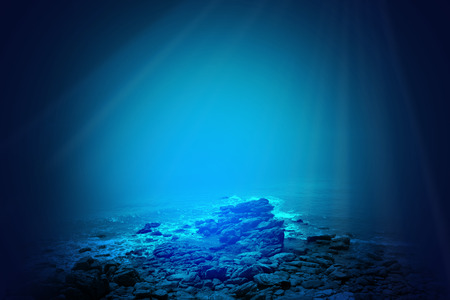 Deep blue sea background with sunlight shining