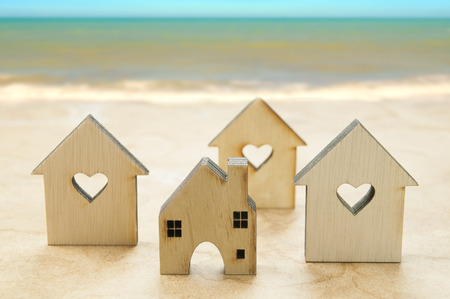 dept: Little houses on sea view background,money saving for new houses and family. Stock Photo