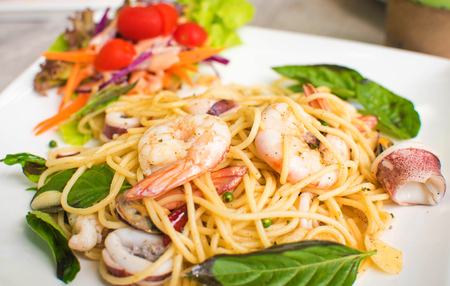 Seafood  Spaghetti with thai style ,hot and spicy taste from fresh pepper. Archivio Fotografico