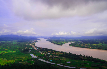View of green filed and Khong river with blue sky background,agriculture from north east Thailand.