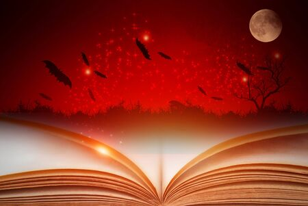 Open magic book with Halloween background