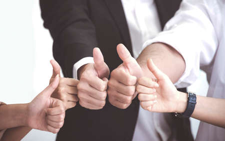 Business People with thumb up after meeting about new normal planning at office