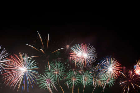 Colorful of fireworks in Happy New Year 2021 holiday festival Фото со стока