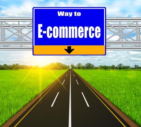 Blue Road Sign concept E-commerce on soft natural landscape background. photo