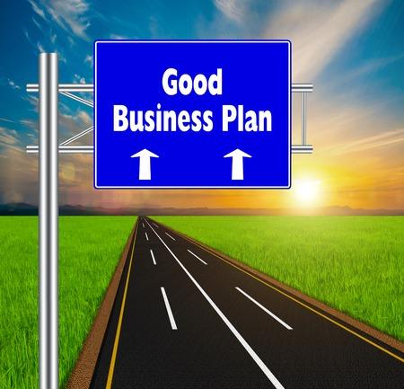 Blue Road Sign concept Good Business Plan on soft natural landscape background. photo