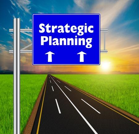 Blue Road Sign concept Strategic Planning on soft natural landscape background. photo