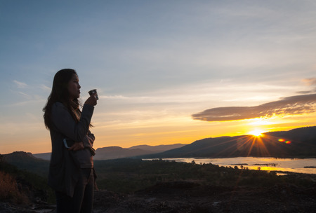 hilltop: Relax and Independent of women is refreshing atmosphere on Hilltop at sunrise Stock Photo