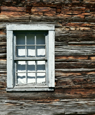 architectural: Detail of window in historic log cabin Stock Photo