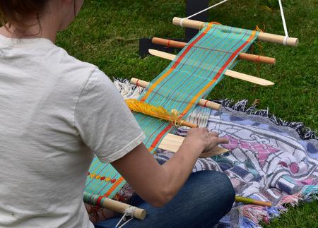 Woman using a hand loom