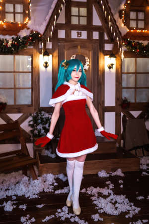 Cute girl cosplaying Christmas  Santa dress around decorations