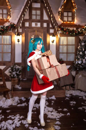 Cute girl cosplaying Christmas  Santa dress with gifts