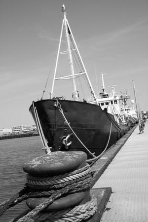 tried: A ship tried up along side the dock