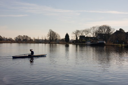 amstel river: A rower on the amstel river.