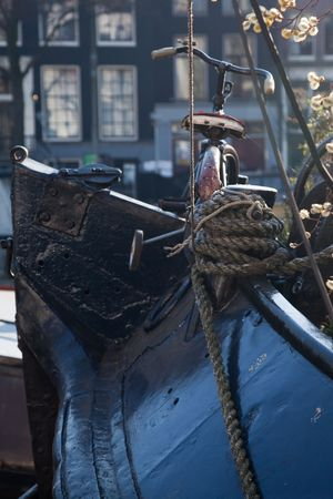 nederland: A childern bike on the bow of a house boat. Stock Photo