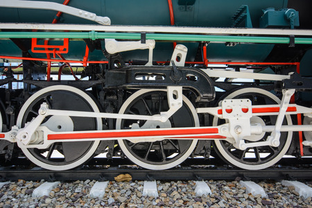 connecting rod: Wheels and connecting rod of old steam locomotive on railway Stock Photo