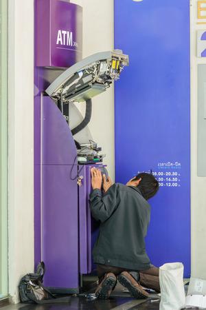 repair and bring money into ATM machine photo