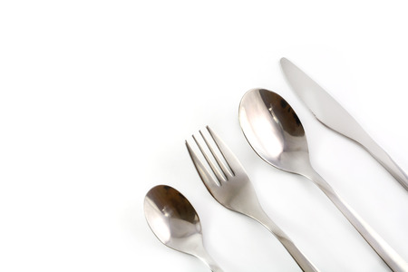Fork, Knife and Spoon set on white background photo