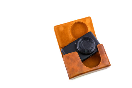 camera with a leather case isolated on white photo