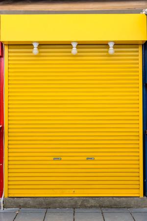 old yellow steel door photo