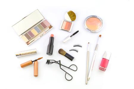 various make up on white background photo