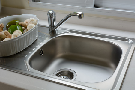 Close up of washbasin in a kitchen