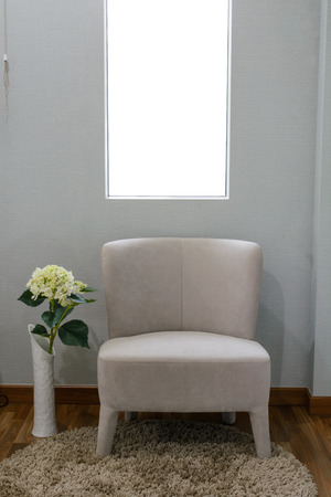 Interior of sofa with flower in bedroom photo