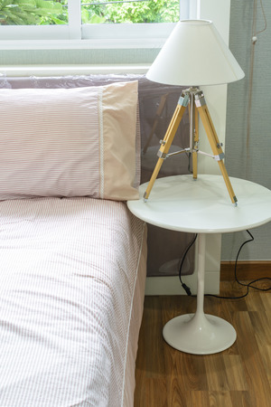 Interior bed room with lamp photo